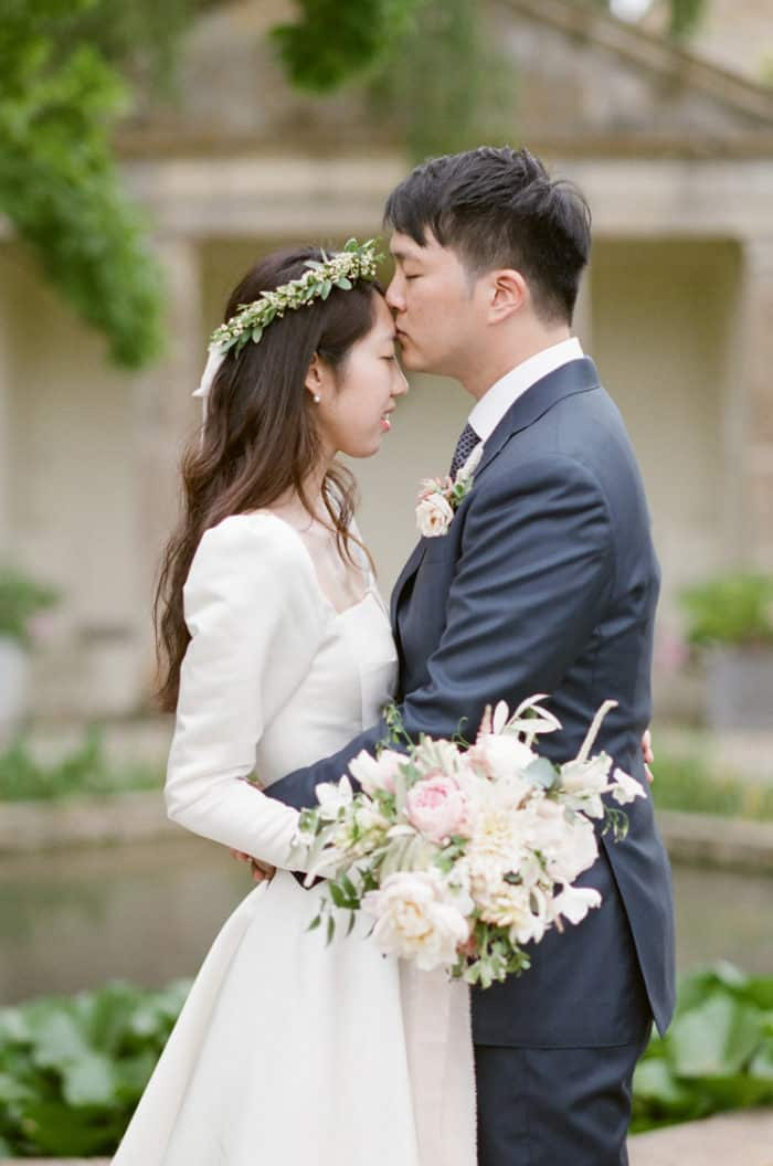 Wedding Couple Kissing On Their Wedding Day At The Barnsley House In The Cotswolds In England