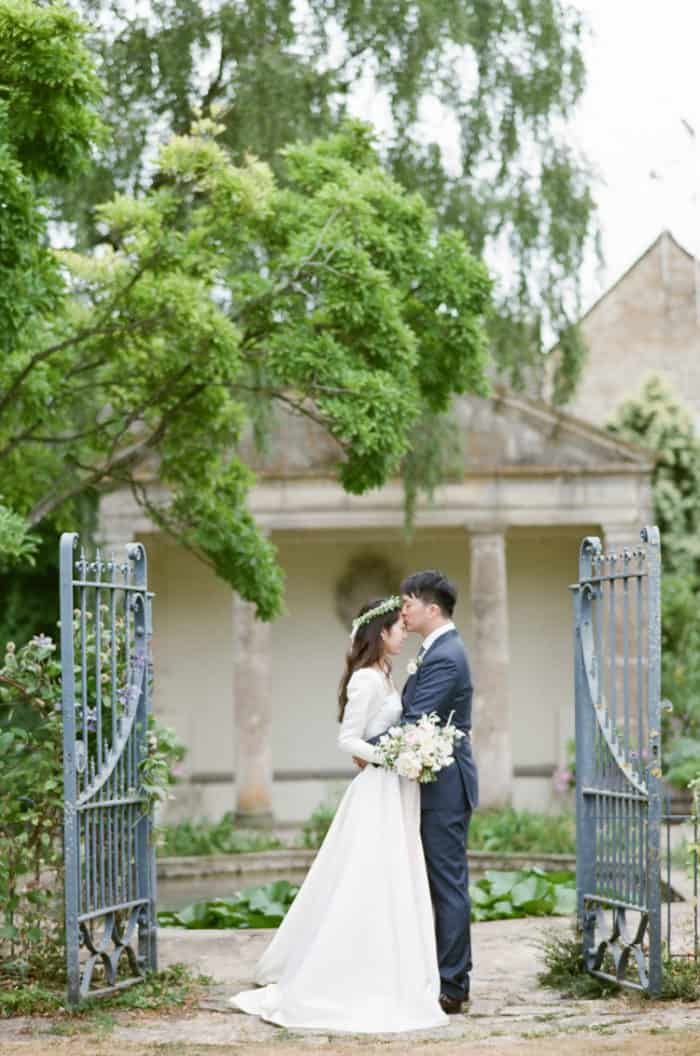 Wedding Couple At The Gardens Of Barnsley House In The Cotswolds In England