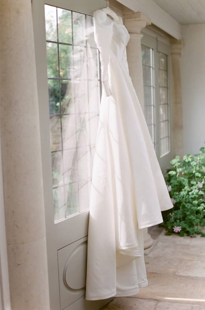 Wedding Dress Hanging In The Bridal Suite Of The Barnsley House In The Cotswolds In England