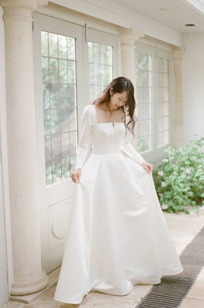 Happy Bride Getting Ready On Her Wedding Day At Barnsley House In The Cotswolds In England