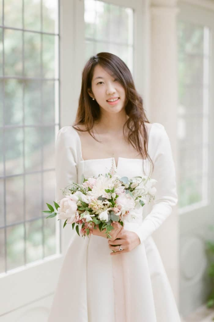 Bride With Her Bridal Bouquet On Her Wedding Day At Barnsley House In The Cotswolds In England