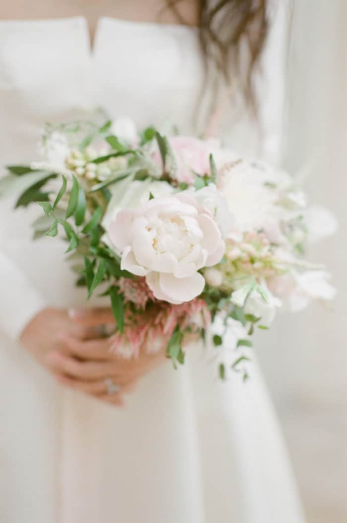 Bride Holding Her Bridal Bouquet On Her Wedding Day At Barnsley House In The Cotswolds In England