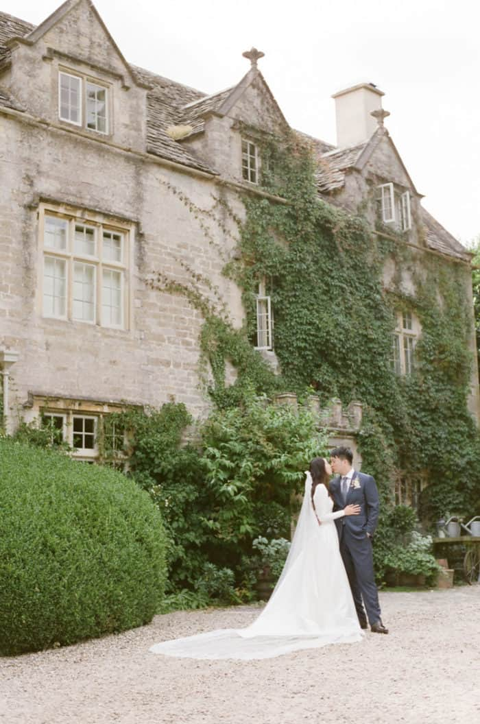 First Kiss Of Bride And Groom After First Look On Their Wedding Day At Barnsley House In The Cotswolds In England