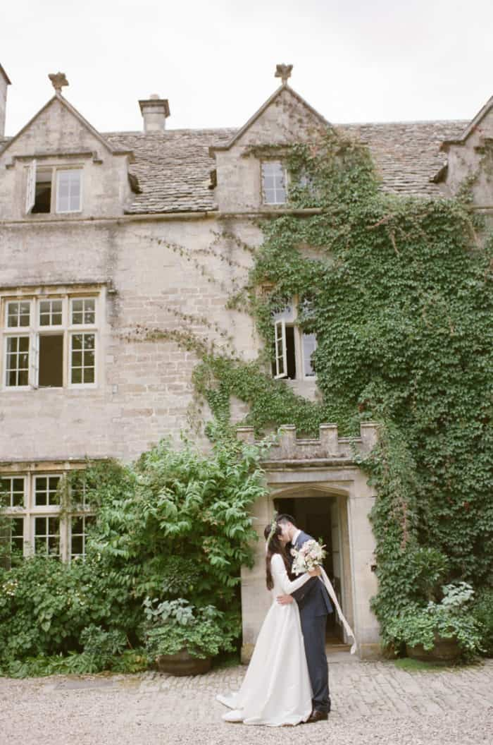 Wedding Coupe In Front Of Barnsley House In The Cotswolds In England On Their Wedding Day
