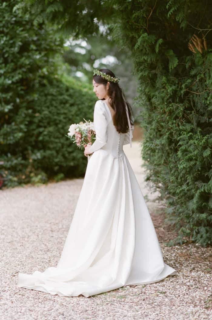 British Bride On Her Wedding Day In Front Of Barnsley House In The Cotswolds In England