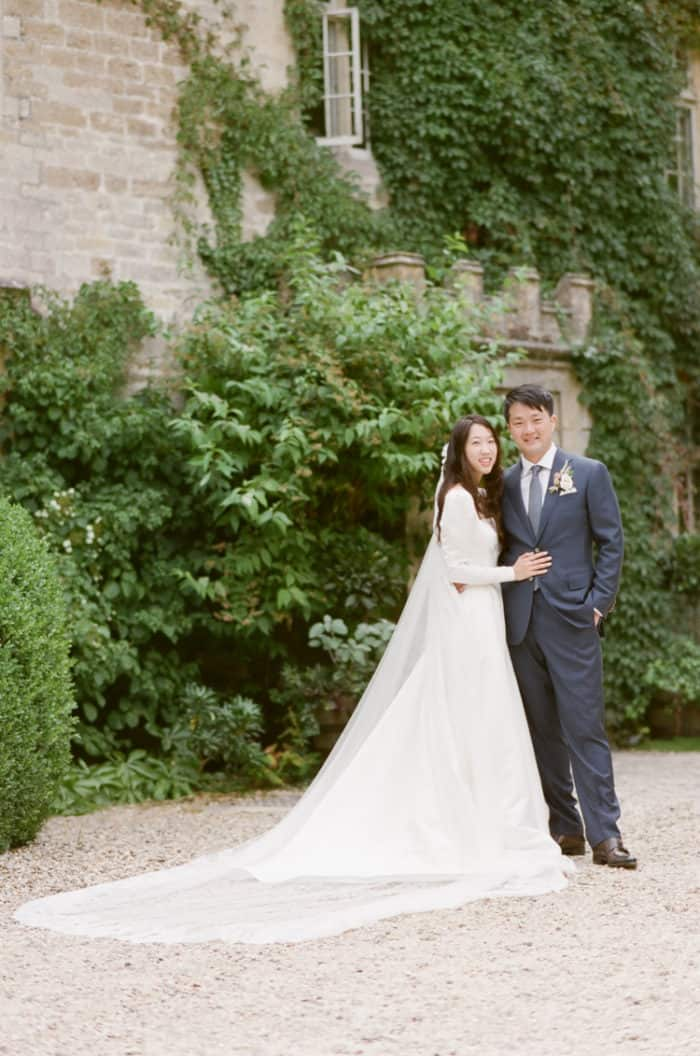 British Couple On Their Wedding Day At Barnsley House In The Cotswolds In England
