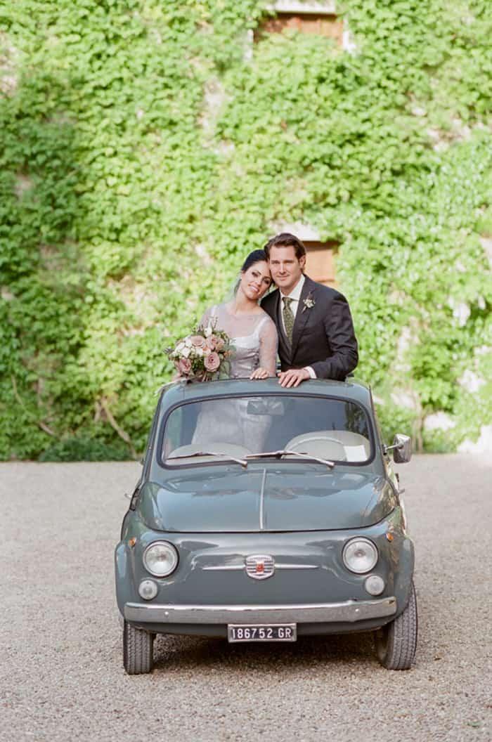 Bride And Groom In Oldtimer Fiat Cinquecento At Borgo Pignano In Tuscany In Italy With Sposiamovi Events