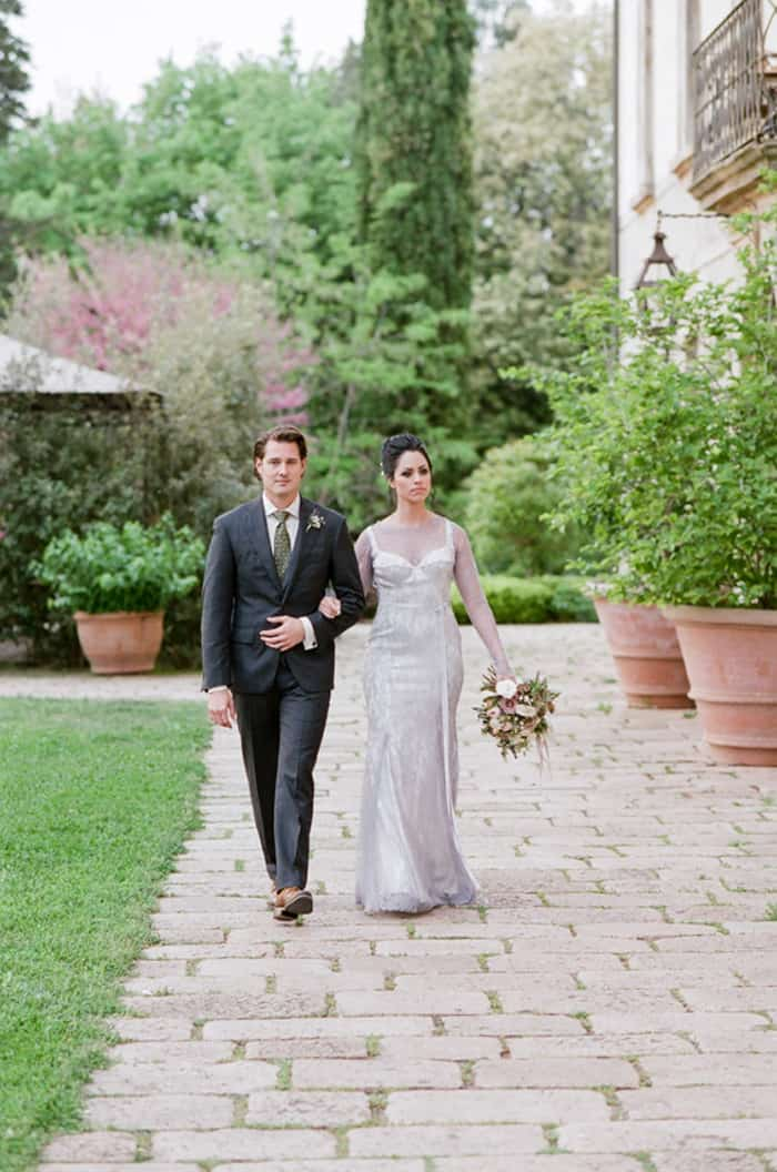 Bride And Groom Walking At Borgo Pignano In Tuscany In Italy With Sposiamovi Events