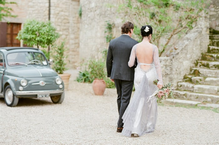 Bride And Groom Walking To Their Reception At Borgo Pignano In Tuscany In Italy With Sposiamovi Events