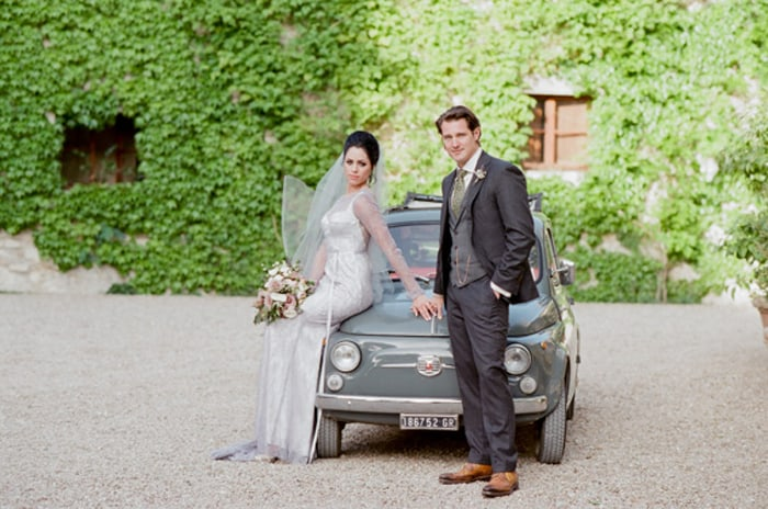 Wedding Couple With Oldtimer Fiat Cinquecento At Borgo Pignano In Tuscany In Italy With Sposiamovi Events