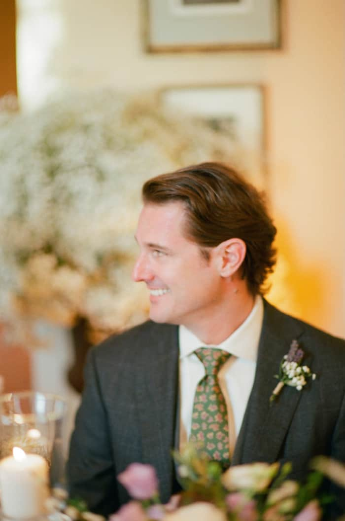 Groom Sitting At His Wedding Reception At Borgo Pignano In Tuscany In Italy With Sposiamovi Events