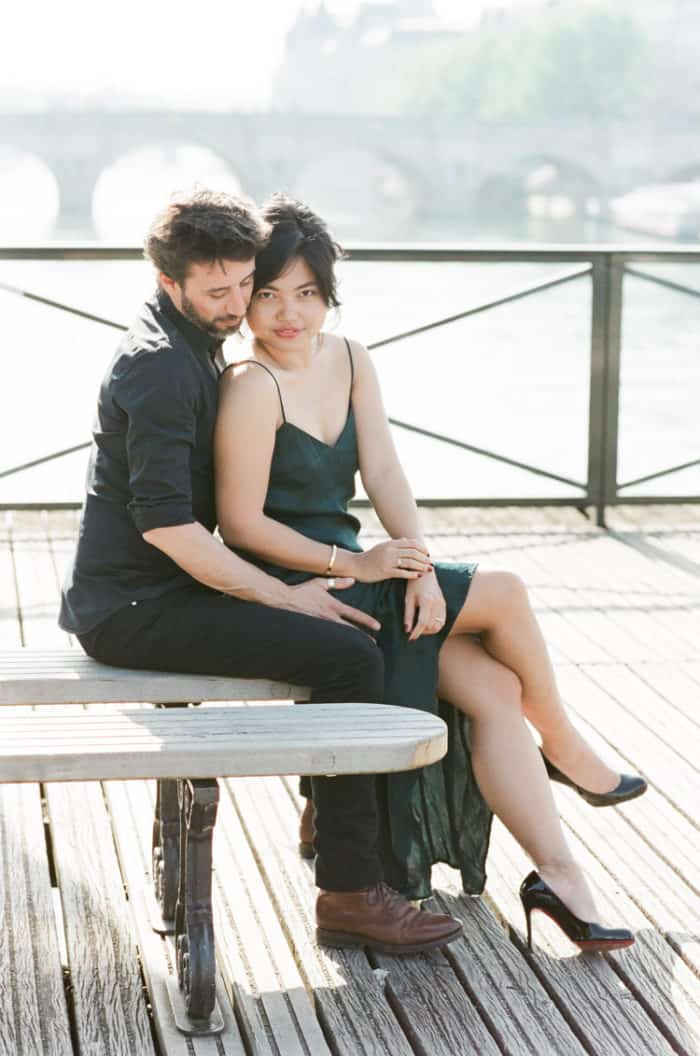 Engaged Couple Sitting On Bridge In Paris Engagement With WEP