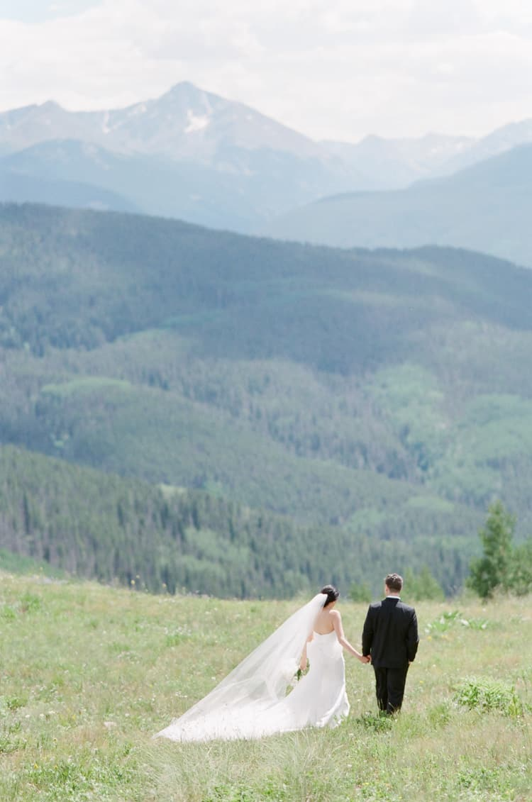 Bride And Groom Walking At Vail Mountain Top With White Birch Weddings