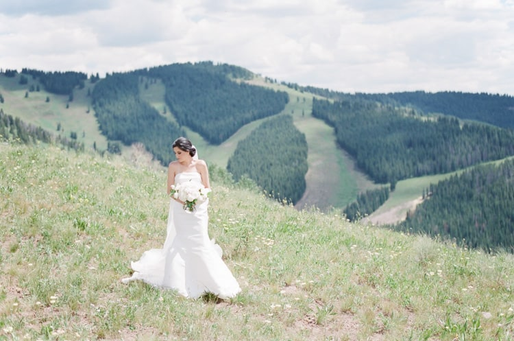 Bride With Mountain Backdrop At Vail Mountain Top Wedding With White Birch Weddings
