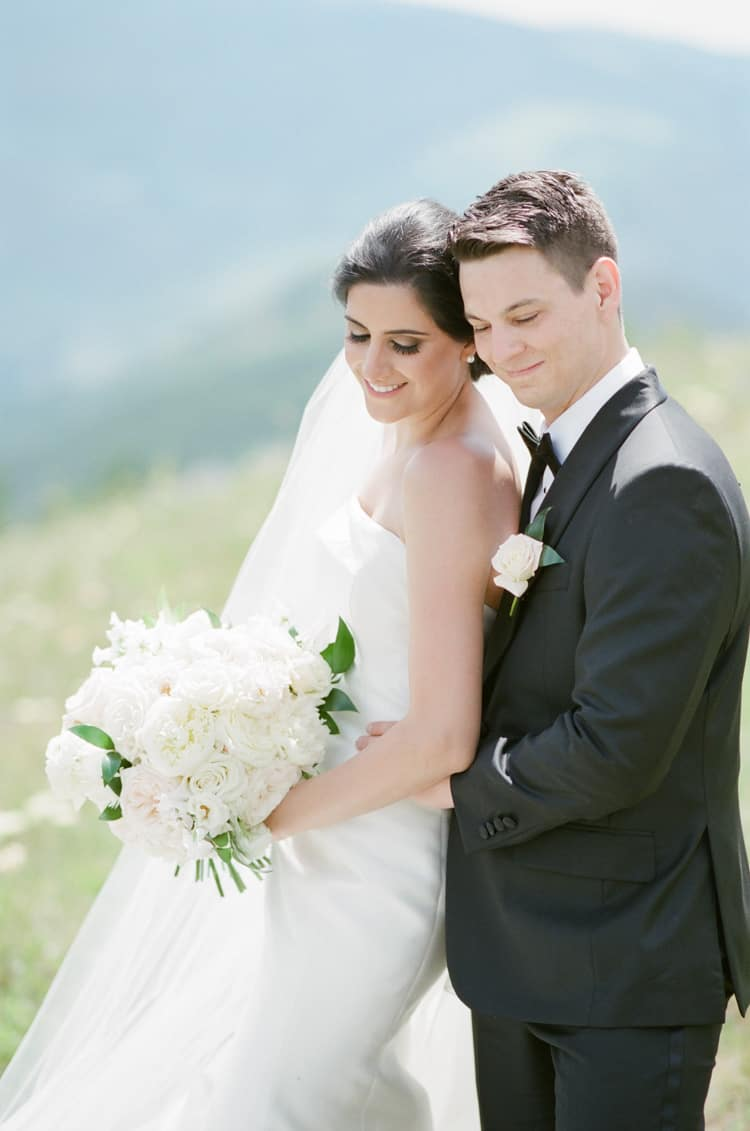 Bride And Groom At Vail Mountain Top Wedding With White Birch Weddings