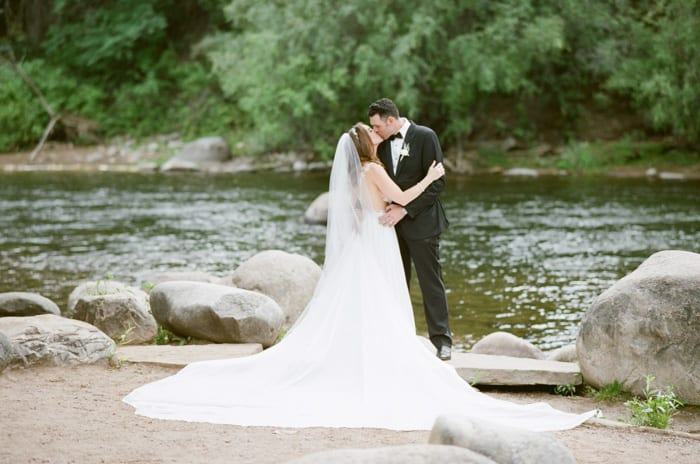 Bride And Groom In Front Of River At The Westin Riverfront And Spa In Beaver Creek With Calluna Events