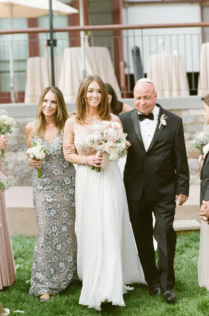 Parents Walking Bride Down The Aisle At Jewish Wedding At The Westin Riverfront And Spa In Beaver Creek With Calluna Events