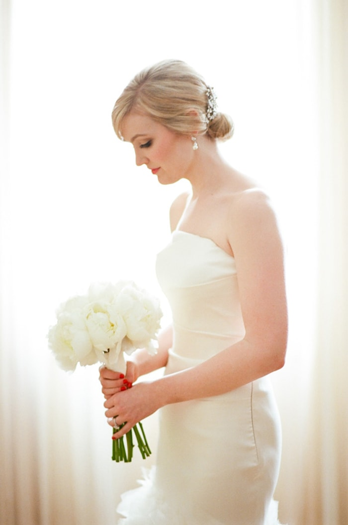 Bride holding a white wedding bouquet at The Rookery in Chicago