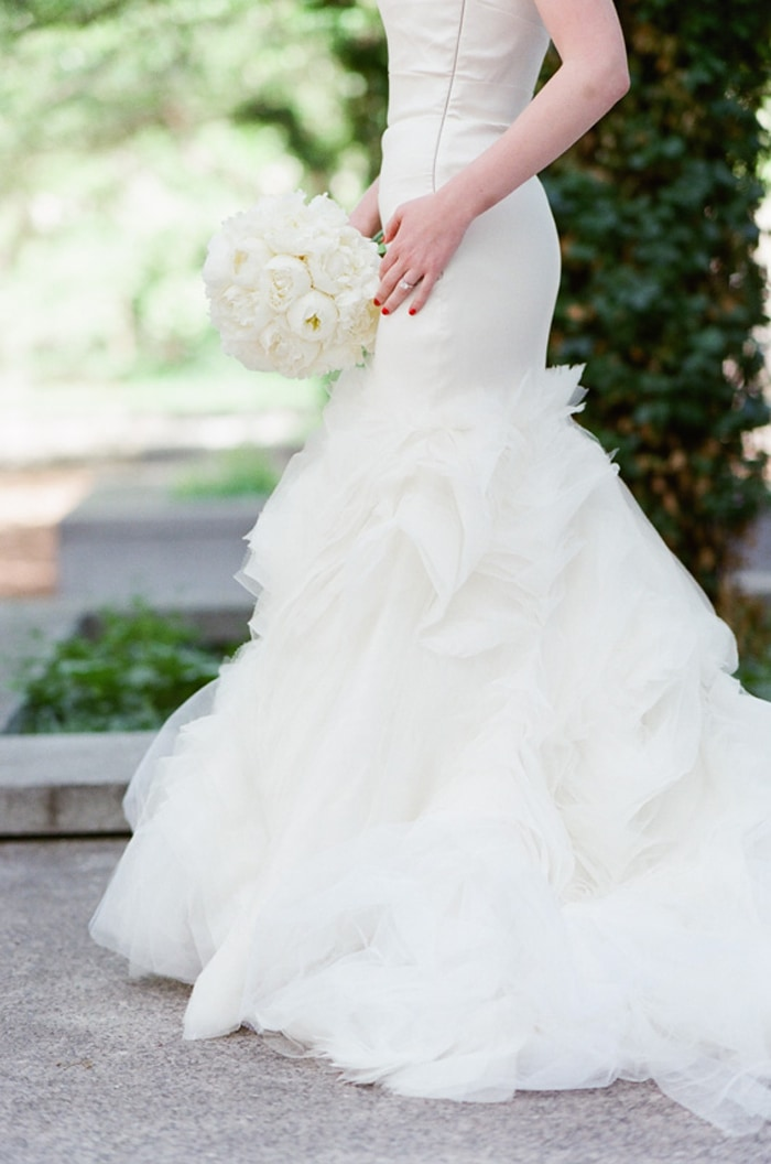 Bride holding a classic white wedding bouquet on her wedding day at The Rookery
