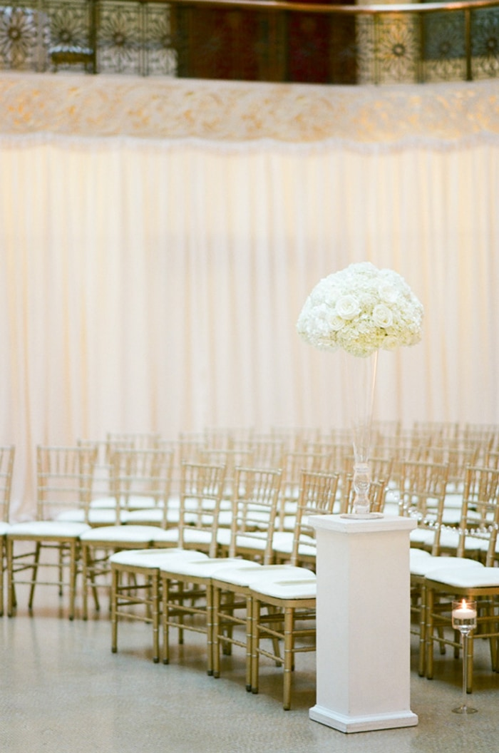 Gold Chiavari chairs at a wedding ceremony at The Rookery in Chicago