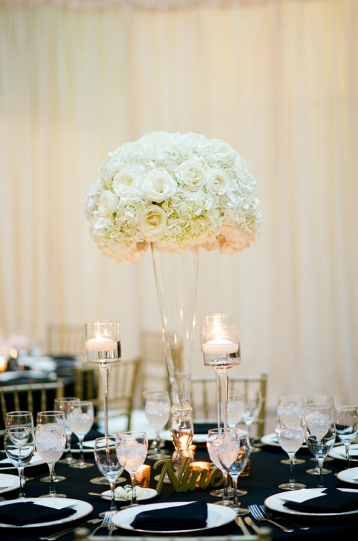 Tall white floral arrangement on a black tablecloth at a wedding reception at The Rookery in Chicago
