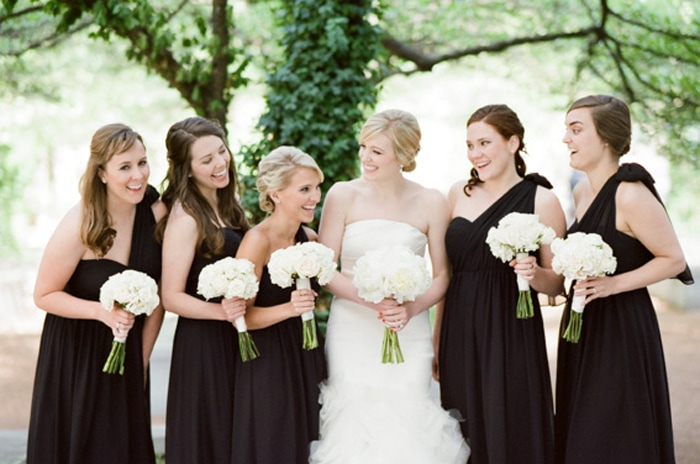 Bride with her bridesmaids in black dresses at The Rookery in Chicago