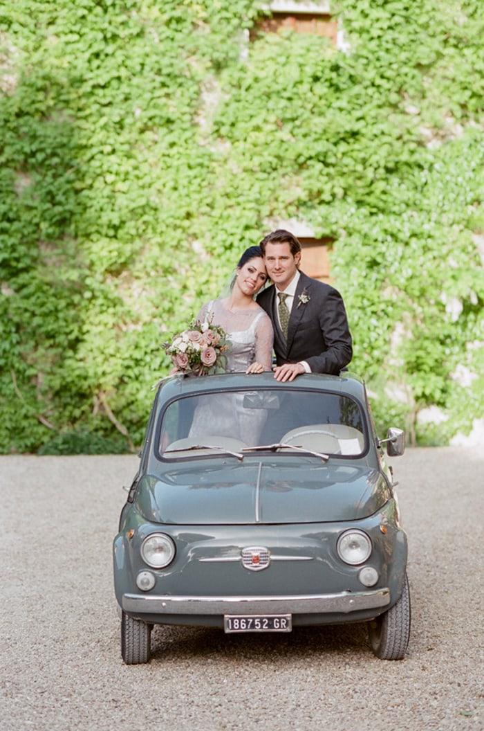Bride and groom in an Italian getaway car