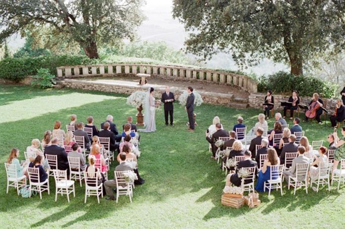 Outdoor destination wedding ceremony in Tuscany Italy at Borgo Pignano