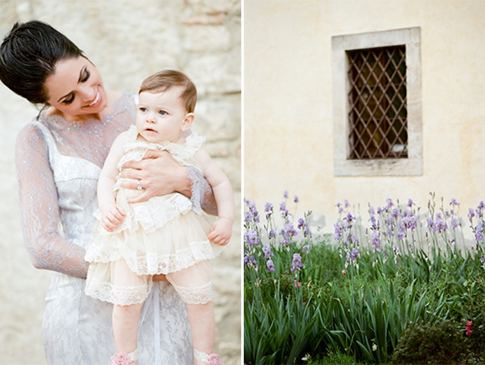 Bride holds a baby at her destination wedding in Tuscany
