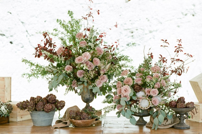 Floral arrangements in muted tones at an elegant destination wedding in Tuscany