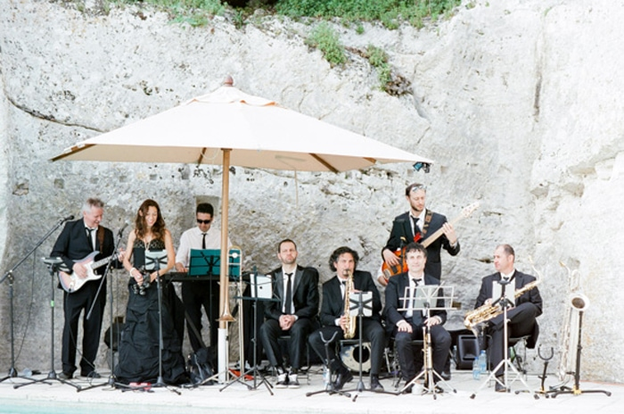 Musicians play at an outdoor wedding in Tuscany Italy