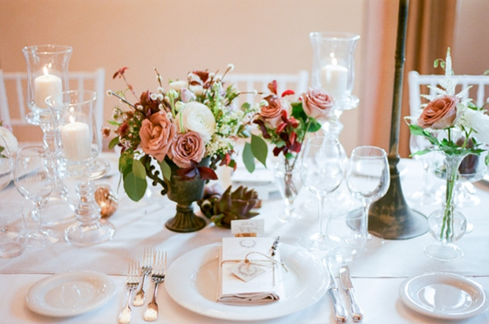 Floral centerpieces at an intimate wedding reception at Borgo Pignano in Tuscany, Italy