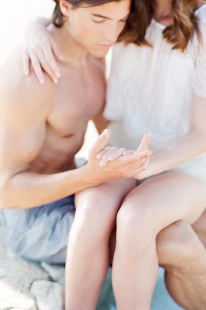Engaged Couple Holding Hands At Pool At La Coquillade At Tamara Gruner Workshops