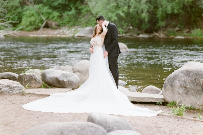 Bride and groom kissing on their wedding day in Beaver Creek Colorado