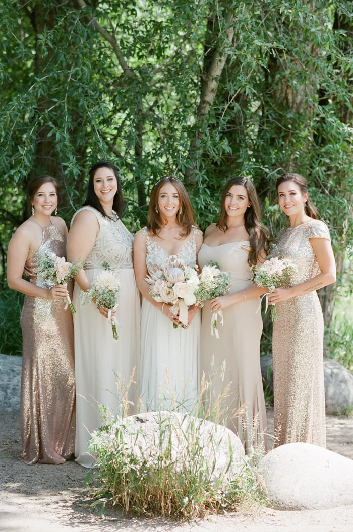 Bride and bridesmaids holding organic bouquets at a wedding in Beaver Creek Colorado