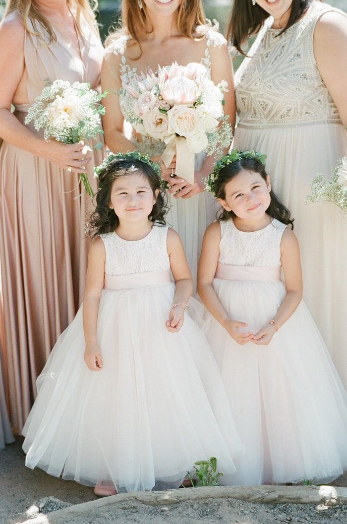 Flower girls in white dresses at a wedding in Beaver Creek Colorado