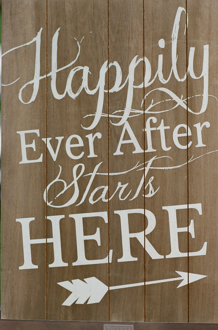 Wooden sign that says Happily Ever After Starts Here