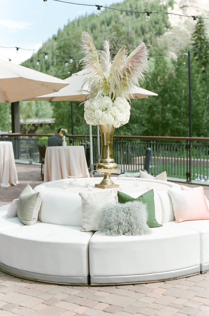 Round banquette with feathergrass arrangement on top at the Westin Riverfront Resort & Spa Beaver Creek