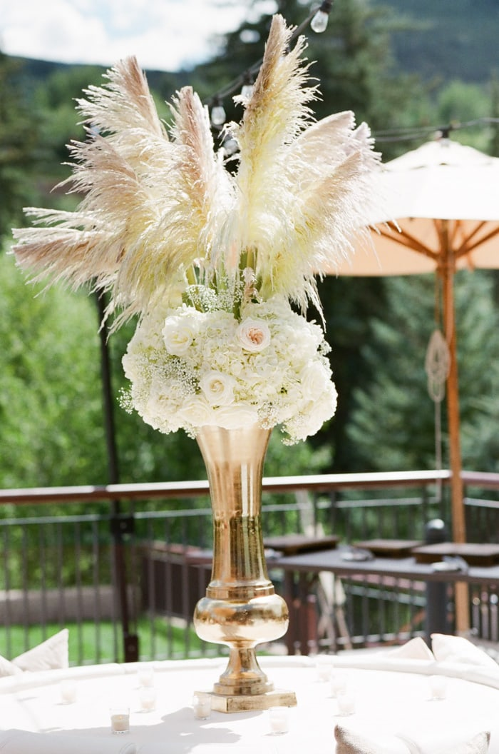 White floral arrangement with feathergrass at the Westin Riverfront Resort & Spa in Beaver Creek