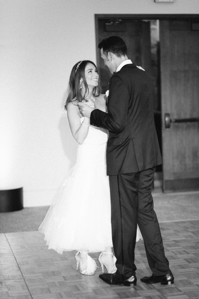 Couple shares a first dance at their wedding reception at the Westin Riverfront Resort & Spa Beaver Creek