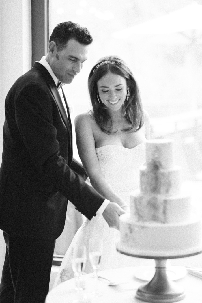 Bride and groom cut the cake at their wedding reception at the Westin Riverfront Resort & Spa Beaver Creek