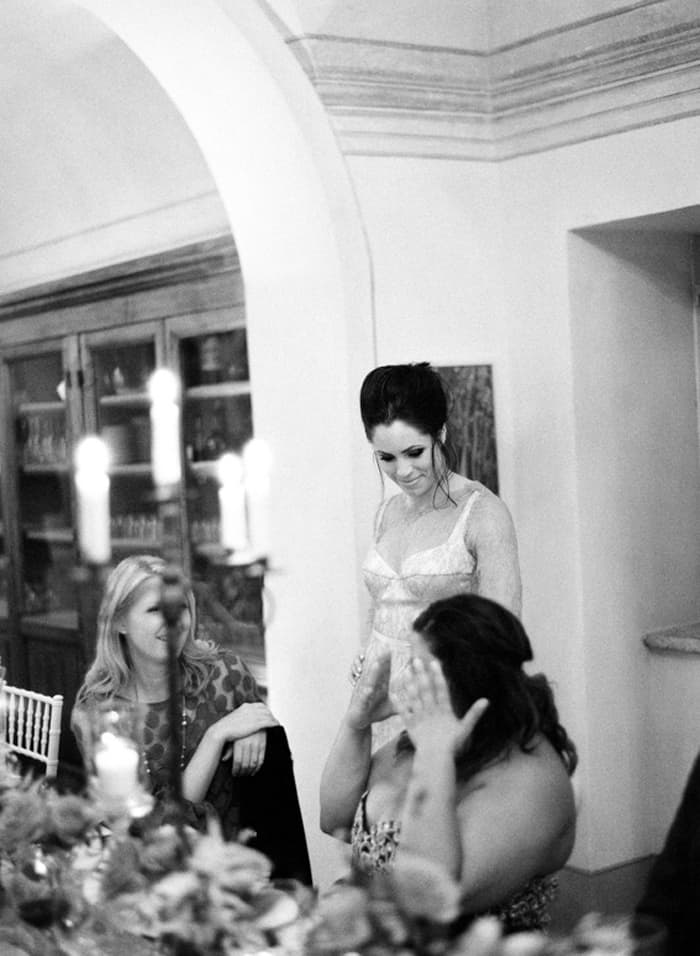 Bride Talking To Her Guests During Wedding Reception At Borgo Pignano In Tuscany In Italy With Sposiamovi Events