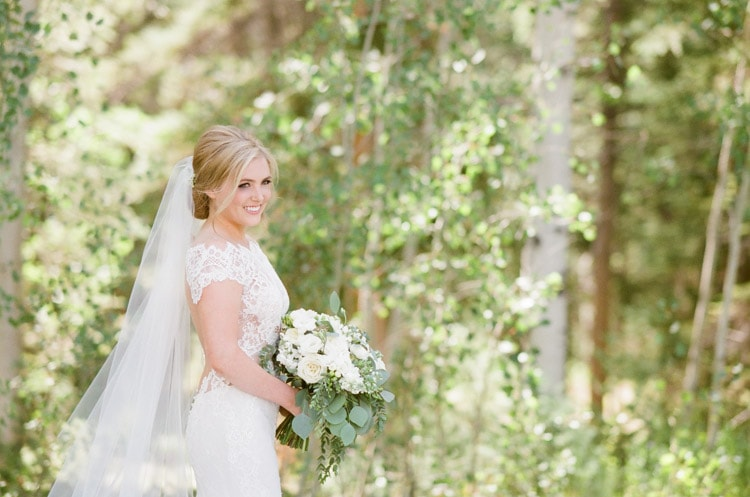Bride holding white bouquet at Eaton Ranch wedding in Vail