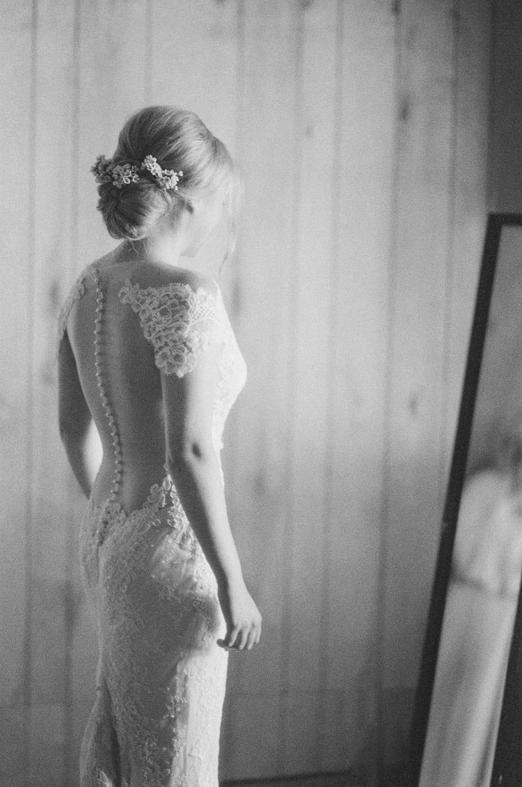 Bride Looking Into The Mirror  At Eaton Ranch Wedding In Vail With Bella Event Design And Planning