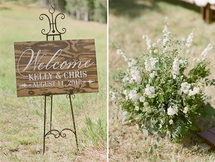 Welcome sign and white floral arrangement at an outdoor wedding ceremony at Eaton Ranch in Vail