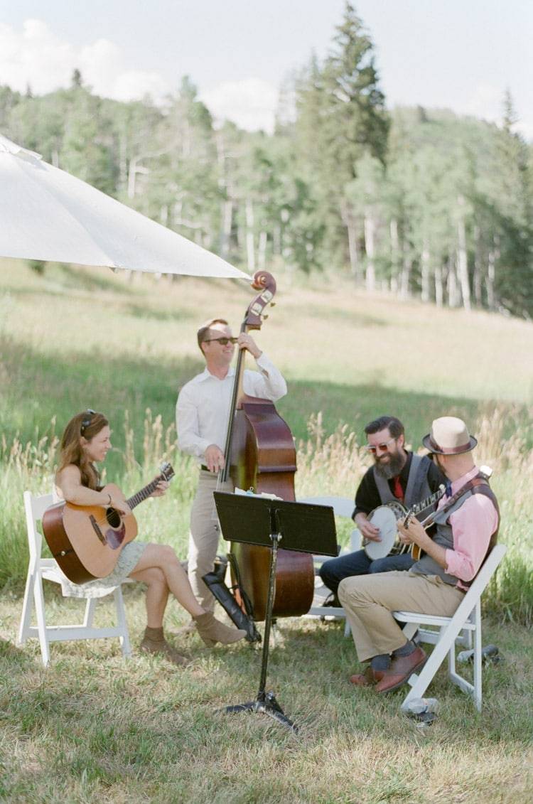 Ceremony musicians play at an outdoor summer wedding in Vail Colorado
