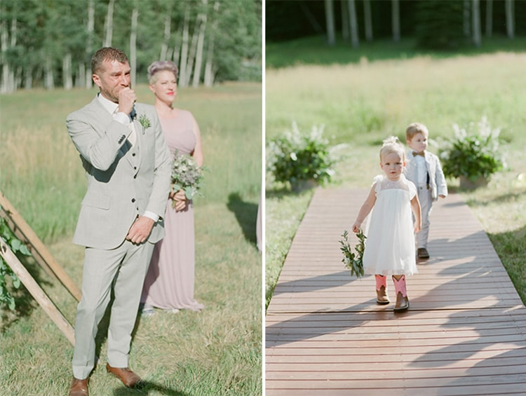 Flower girl walks down the aisle at an outdoor wedding in Vail Colorado