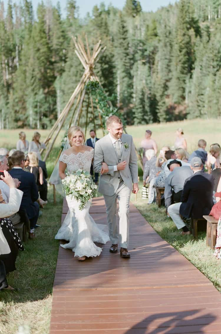 Bride And Groom Walking Down The Aisle At Eaton Ranch Wedding Ceremony In Vail With Bella Event Design And Planning