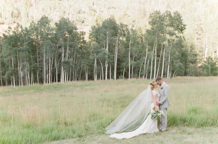 Bride And Groom In Field At Eaton Ranch Wedding In Vail With Bella Event Design And Planning