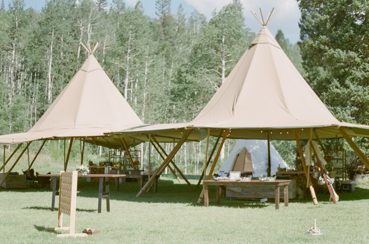 Modern teepee lounge area at an outdoor wedding reception in Vail Colorado